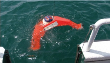 A photo of an Acoustic Doppler Current Profiler being deployed on the lakebed of Lake Ontario for the 2009 survey season.