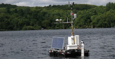 A photo of The Harp Environmental Lake Monitoring Ark, showing its deployment in Harp Lake in June 2010 to collect environmental data from above and below the water surface and transmit these data in near real time.