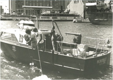 A photo of Ministry of the Environment staff collecting water samples in Toronto Harbour aboard the Monitor Second, circa 1978.
