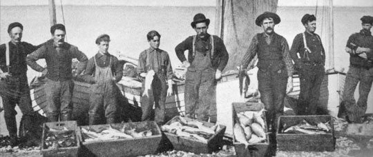 black and white photo of early commercial fishers with their catch from the Bay of Quinte.