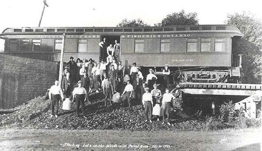 black and white photo of a specially equipped railway car, which was used to distribute many bass across northern Ontario.