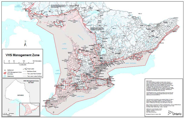 Map of Southern Ontario showing Viral Hemorraghic Septicemia (VHS) management zone implemented in April 2007. The map legend shows settlements indicated with black dots, Viral Hemorraghic Septicemia (VHS) management zone boundary indicated by a red line with light red shading, and waterbodies indicated by blue. Multilane, two lane hard surface and two lane loose surface roads are shown by black lines.