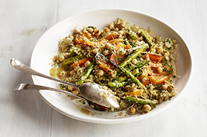 Quinoa and Grilled Asparagus salad in a white bowl