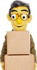Photo of Sheldon holding moving boxes.