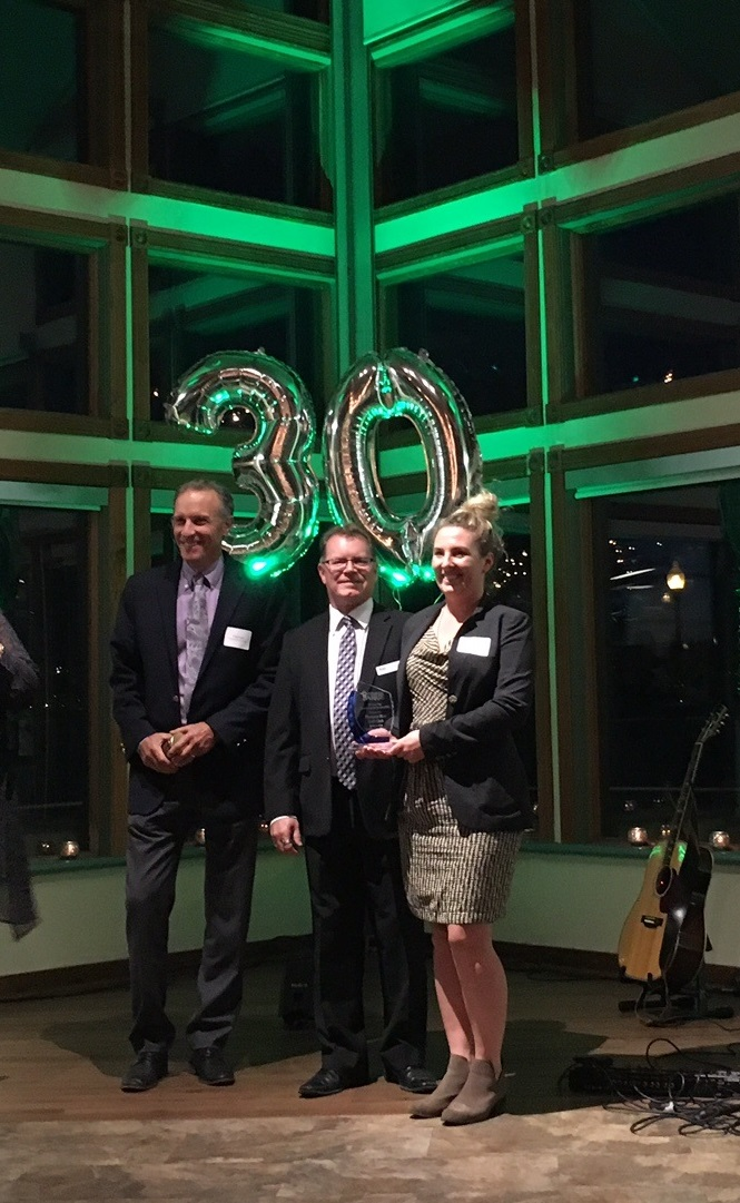 This image shows staff from Pheasant Run Golf Course receiving an award from Tourism Barrie for Environmental Sustainability