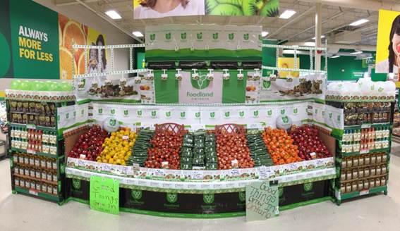 A photo of a retail grocery display in a Food Basics store featuring Ontario-grown produce and the Foodland Ontario logo.