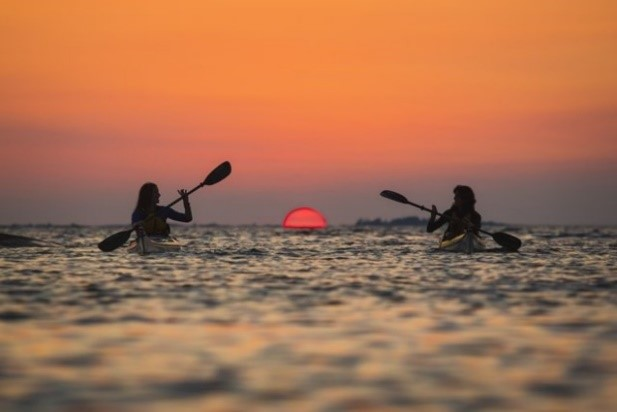 Photograph of two people canoeing at Snug Harbour, Georgian Bay