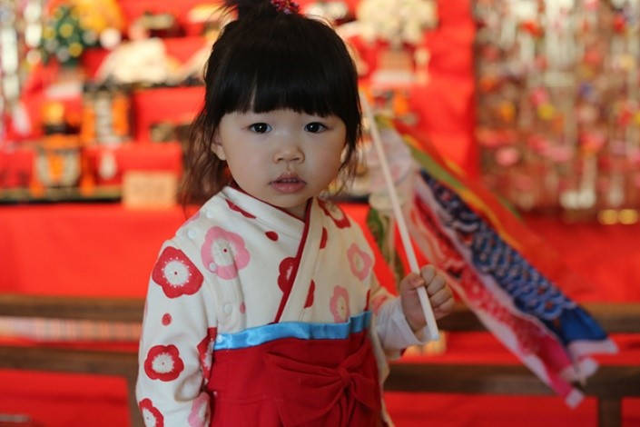 Photograph of a child at the Carrousel of Nations in Toronto