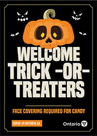 orange jack-o-lantern with the words Welcome trick-or-treaters, face covering required for candy in white letters