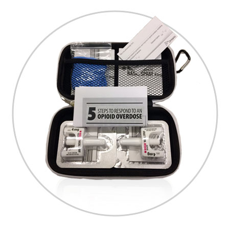 Picture of what is in Nasal spray kits: 1 hard case, 2 doses of Narcan® Nasal Spray, 1 pair of gloves, 1 card that identifies the person who is trained to give the naloxone, 1 insert with instructions, 1 insert with additional information on the medication