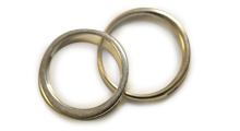 An image of two wedding bands overlapping symbolizing a union