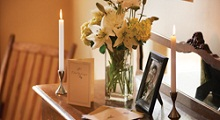 photo with flowers and candles on cabinet
